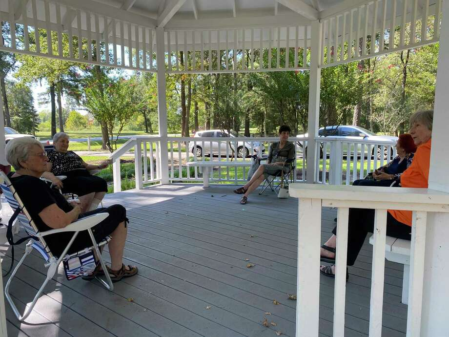 A group of six ladies meet each Monday at noon at the River Plantation gazebo for lunch. The ladies miss all of their activities they were engaged in prior to the COVID-19 pandemic. Meeting socially distanced once a week brings a fellowship that they look forward to each week. Pictured from left clockwise are Glenda Thames, Mary Gallo, MaryAnn Innes, Jo Viggiano and Mardell Lawhead. Sixth member Mary Beth Lozano was not at Monday's visit. Photo: Photo By Sondra Hernandez