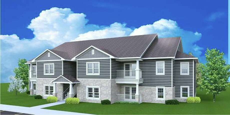 This is an architectural rendering of one of the planned six two-story garden-style buildings that will be constructed at Diamond Apartments of Jerseyville, with four units on each level and a central breezeway providing access to the second story.