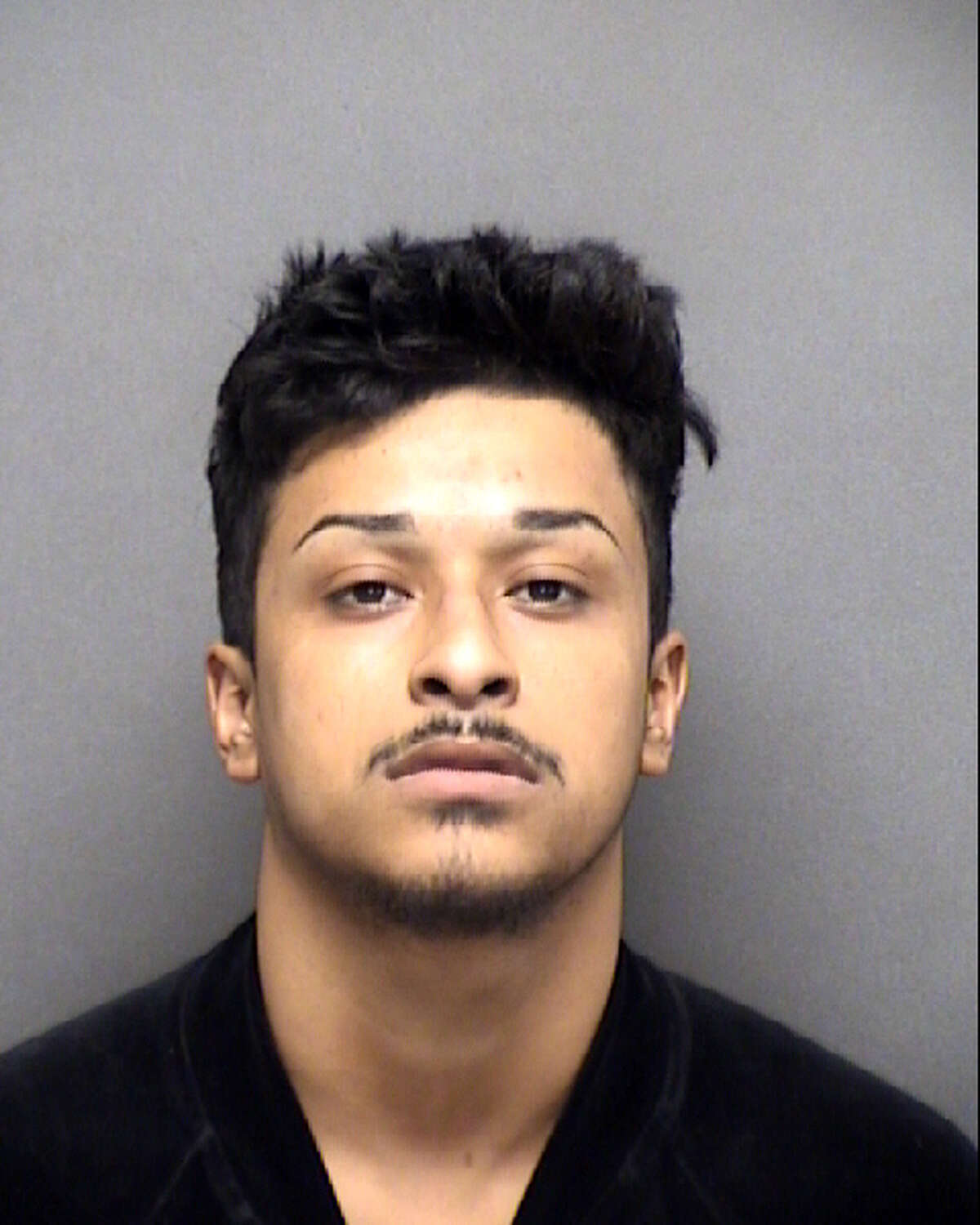 Adrian Cardenas, 22, has been charged with attempted capital murder of a police officer after shooting at San Antonio police officers.