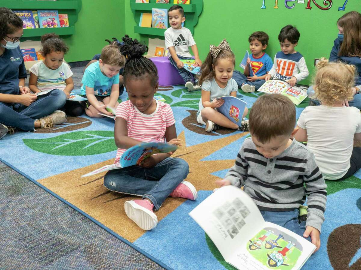 Midland College Pre-K Academy students read through their own copy of Pete the Cat, Firefighter Pete, by James Dean, 10/06/2020 morning after Midland firefighters read the story to them. Tim Fischer/Reporter-Telegram