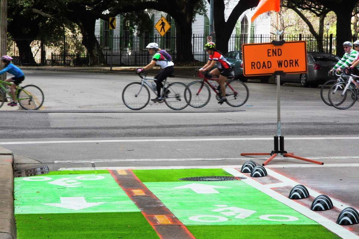 Cyclists ride by the bike lanes in downtown Houston, which were built in 2015.