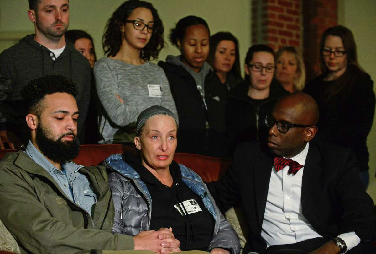 Kathleen Slonski, center, the mother of the victims of a deadly car crash that left Vincent Fowlkes dead and Shawn Bowman in serious condition following a police pursuit, and her other son, Prentiss Elmore, left, held a press conference Friday, January 27, 2017, with their attorney Darnell Crosland, right, at Clocktower Close in Norwalk, Conn.