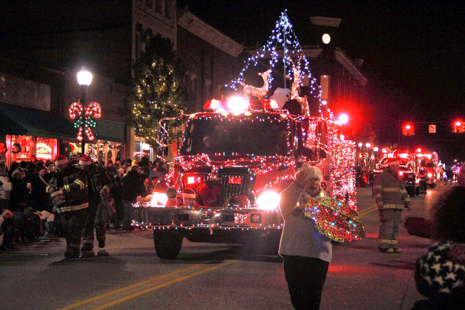 Last year, hundreds of area residents gathered to watch floats decorated in twinkling Christmas lights stroll down Michigan Avenue. Featured is a photo from last year's festivities. Photo: Pioneer File Photo