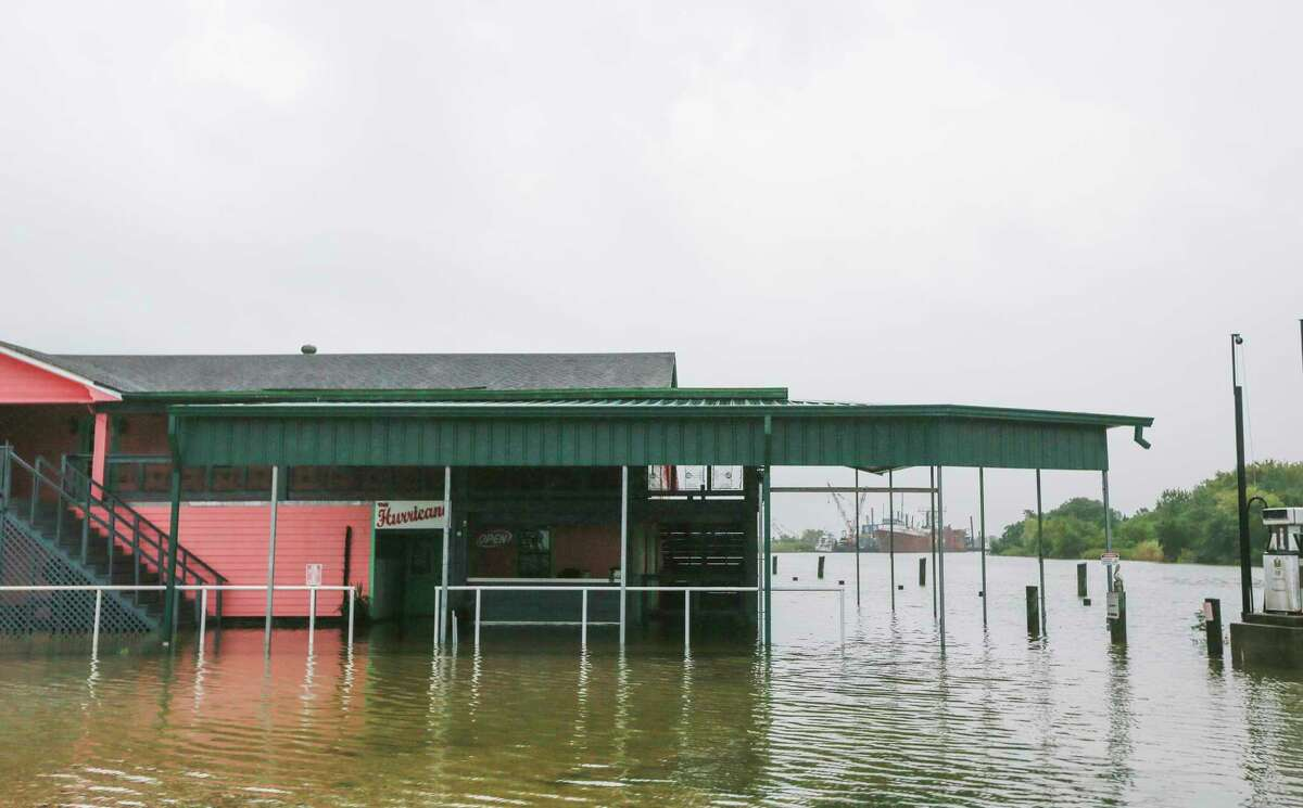 Water laps up to The Hurricane, a bar in Oak Island, Texas on Tuesday, Sept. 22, 2020.