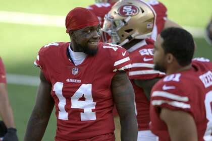San Francisco 49ers wide receiver Mohamed Sanu (14) speaks with teammates during the second half of an NFL football game against the New York Jets Sunday, Sept. 20, 2020, in East Rutherford, N.J. (AP Photo/Bill Kostroun)