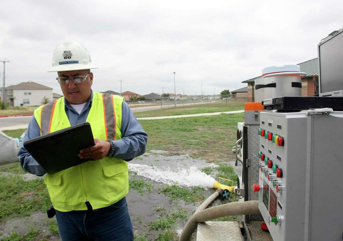 Manuel Gonzales, a SAWS senior meter technician, tests the meter at Paschall Elementary School in 2012. SAWS is planning to kick-start its Connect H2O program in February, when 2,500 advanced meters will be installed in downtown, the West Side and Stone Oak areas to relay readings in near real-time online.