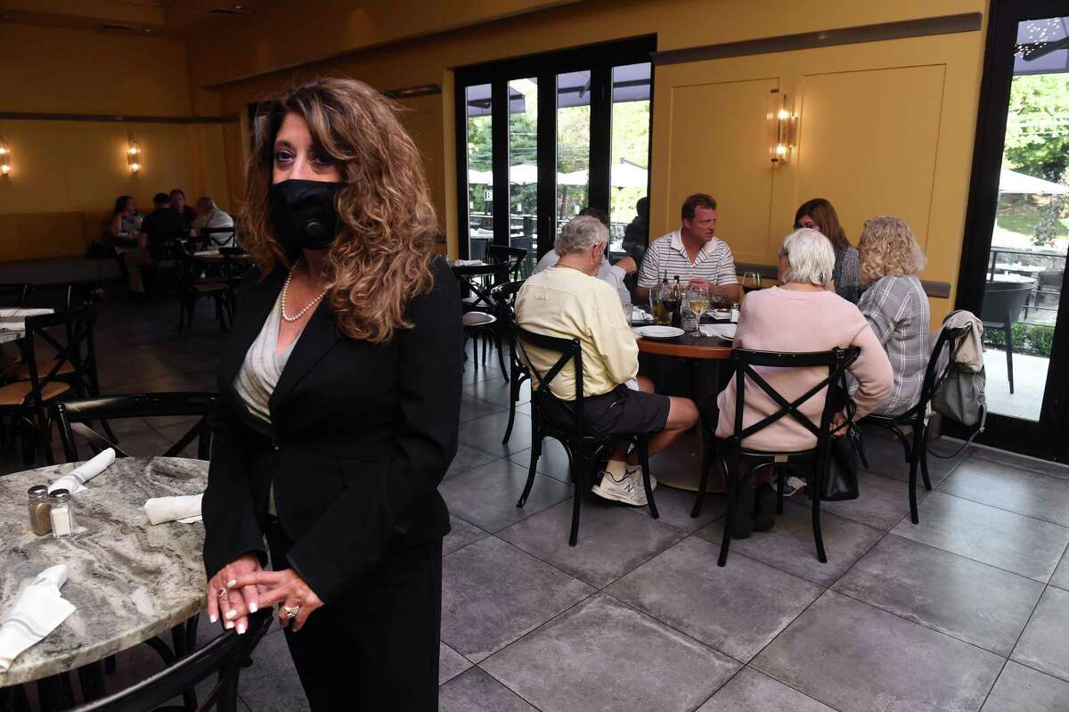 General Manager Heidi Heidkamp is photographed in one of the indoor seating areas of Viron Rondo Osteria in Cheshire on Oct. 5, 2020. Restaurants will be reduced to 50 percent indoor seating capacity. During Phase 3, restaurants were allowed up to 75 percent indoor seating capacity. Groups will be limited to eight people per table while sitting indoors at restaurants. Restaurants and entertainment venues will be required to close by 9:30 p.m. Takeout and delivery will still be allowed past 9:30 p.m.