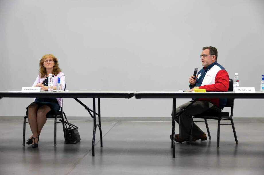 Carol Langley, left and Mark Ferraz, right, sit six feet apart during a community forum for the upcoming elections at the Lone Star Community Center in Montgomery, Tuesday, Sept, 30, 2020. Langley and Ferraz are running against one another for the City Council Place 1 position. Photo: Gustavo Huerta, Houston Chronicle / Staff Photographer / 2020 © Houston Chronicle
