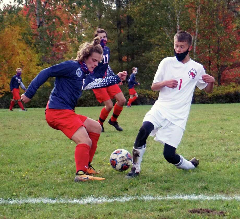 Big Rapids junior Aiden Herron fights for possession of the ball along the sideline with Reed City freshman Austin Woods during BR's 4-0 win over the Coyotes on Oct. 1. (Pioneer photo/Joe Judd)