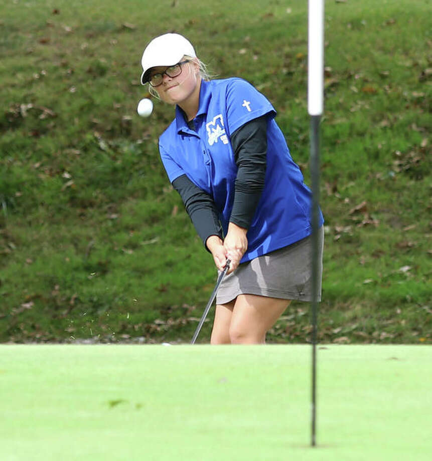 Marquette Catholic junior Audrey Cain chips onto the three on hole No. 3 at Oak Brook during Thursday's Gair Bair Invite in Edwardsville. Cain and the Explorers open postseason play Wednesday in the Marquette Class 1A Regional at Spencer T. Olin in Alton. Photo: Greg Shashack / The Telegraph
