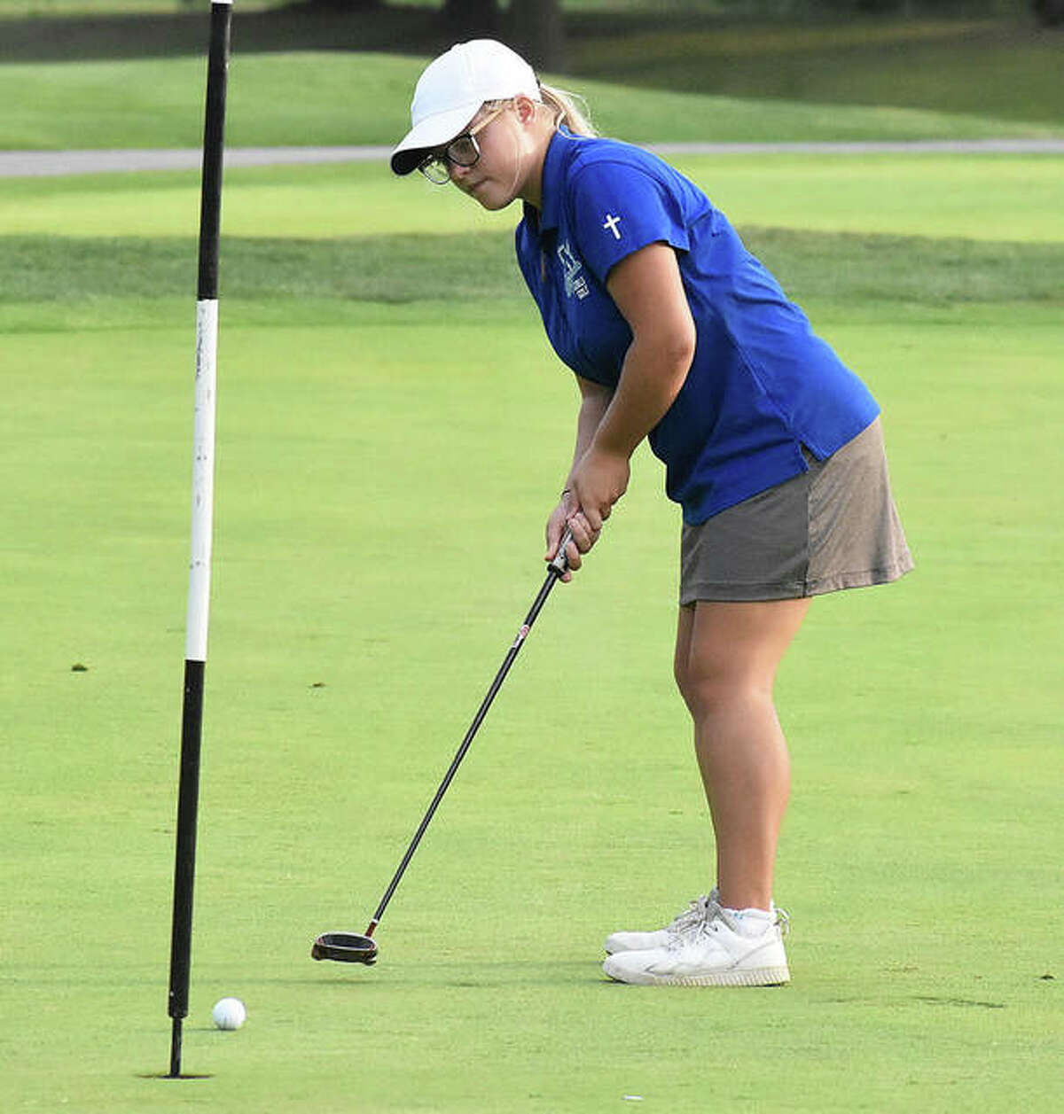 Marquette's Audrey Cain watches her putt roll into the cup for a birdie on the par 5, hole No. 9 at Spencer T. Olin during a Sept. 16 match in Alton. Cain will be back at Olin on Wednesday for the Marquette Class 1A Regional.