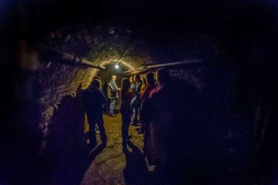 In this file photo, a group takes a tour with Alton Hauntings, exploring Alton's legendary haunted history.