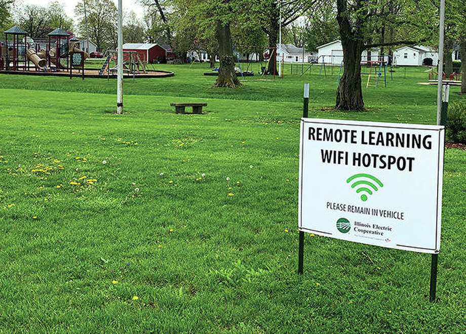 A sign in the park at Woodson lets people know there is a remote learning Wi-Fi hot spot that can provide students an internet connection to do their school work. Photo: Journal-Courier