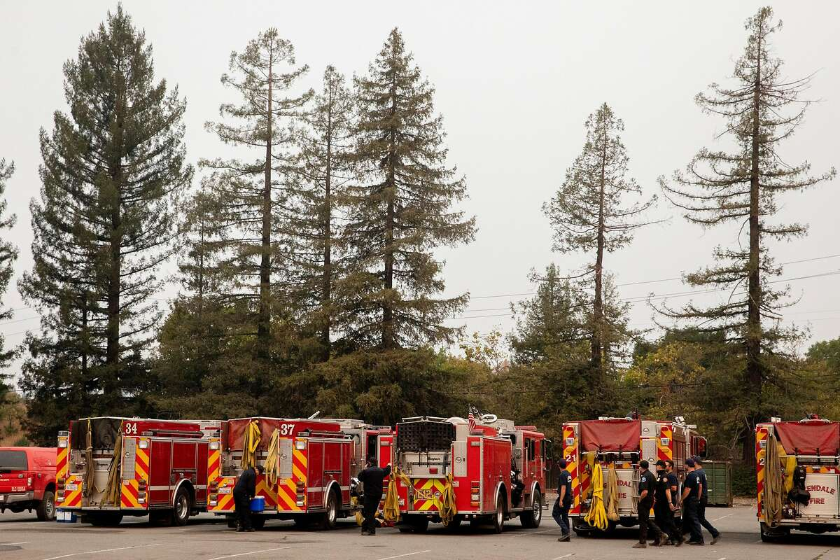 Crews fighting the Glass Fire in Sonoma and Napa counties rest Thursday at Cal Fire's Santa Rosa base.
