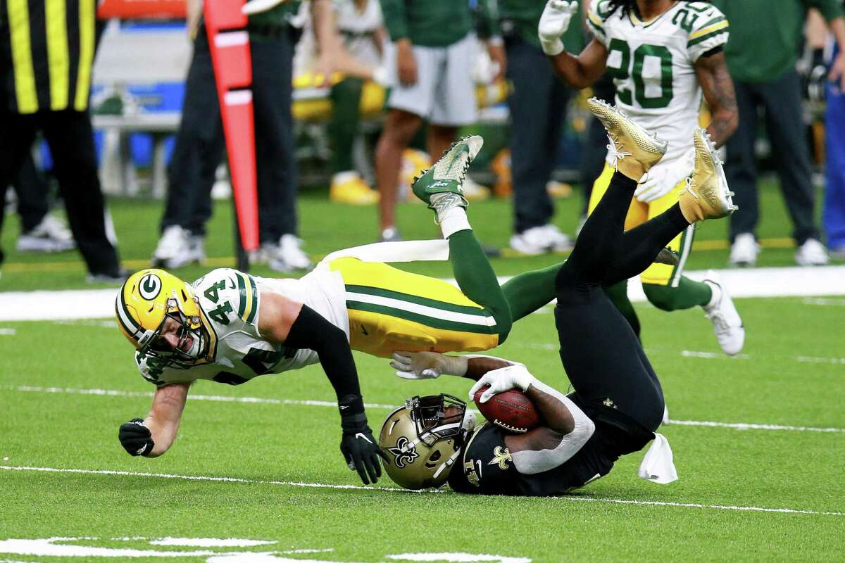 NEW ORLEANS, LOUISIANA - SEPTEMBER 27: Alvin Kamara #41 of the New Orleans Saints is tackled by Ty Summers #44 of the Green Bay Packers during the first half at Mercedes-Benz Superdome on September 27, 2020 in New Orleans, Louisiana. (Photo by Sean Gardner/Getty Images)