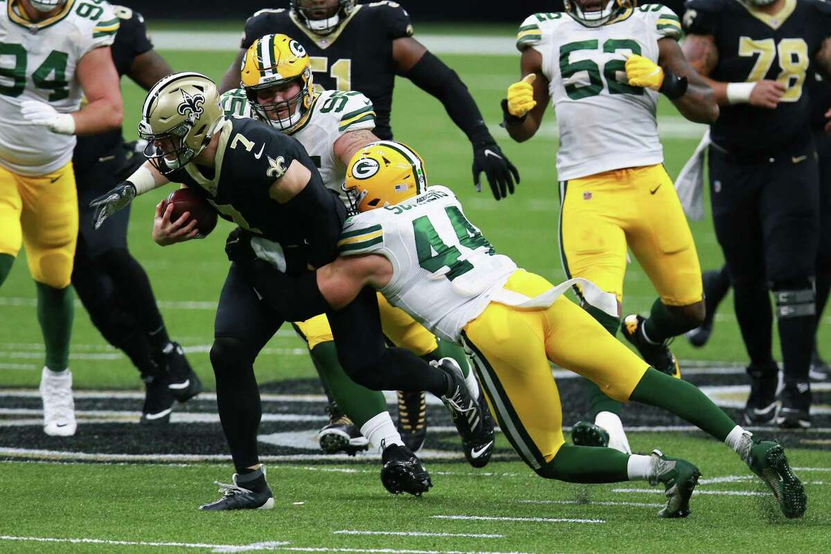 NEW ORLEANS, LOUISIANA - SEPTEMBER 27: Taysom Hill #7 of the New Orleans Saints is tackled by Ty Summers #44 of the Green Bay Packers during the second half at Mercedes-Benz Superdome on September 27, 2020 in New Orleans, Louisiana. (Photo by Sean Gardner/Getty Images)