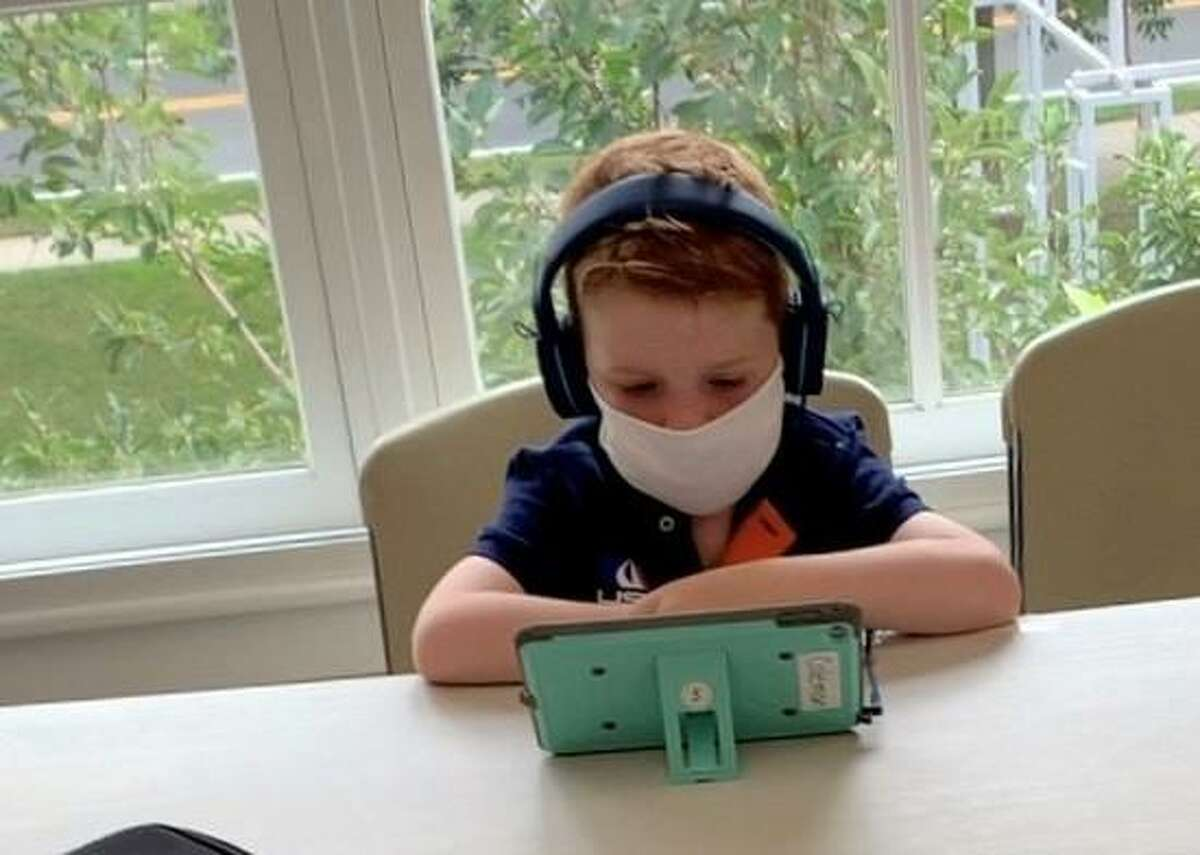 Students participate in distance learning at the Guilford Center for Children's full-day program, designed to supplement the schools' hybrid learning model. Oct. 6, 2020 at the Nathanael B. Greene Community Center in Guilford, Conn.