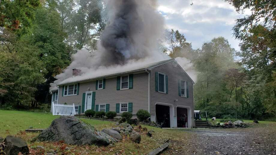 The house fire on Carriage Lane in Danbury, Conn., the morning of Oct. 6, 2020, that displaced seven people. Photo: Danbury Fire Department