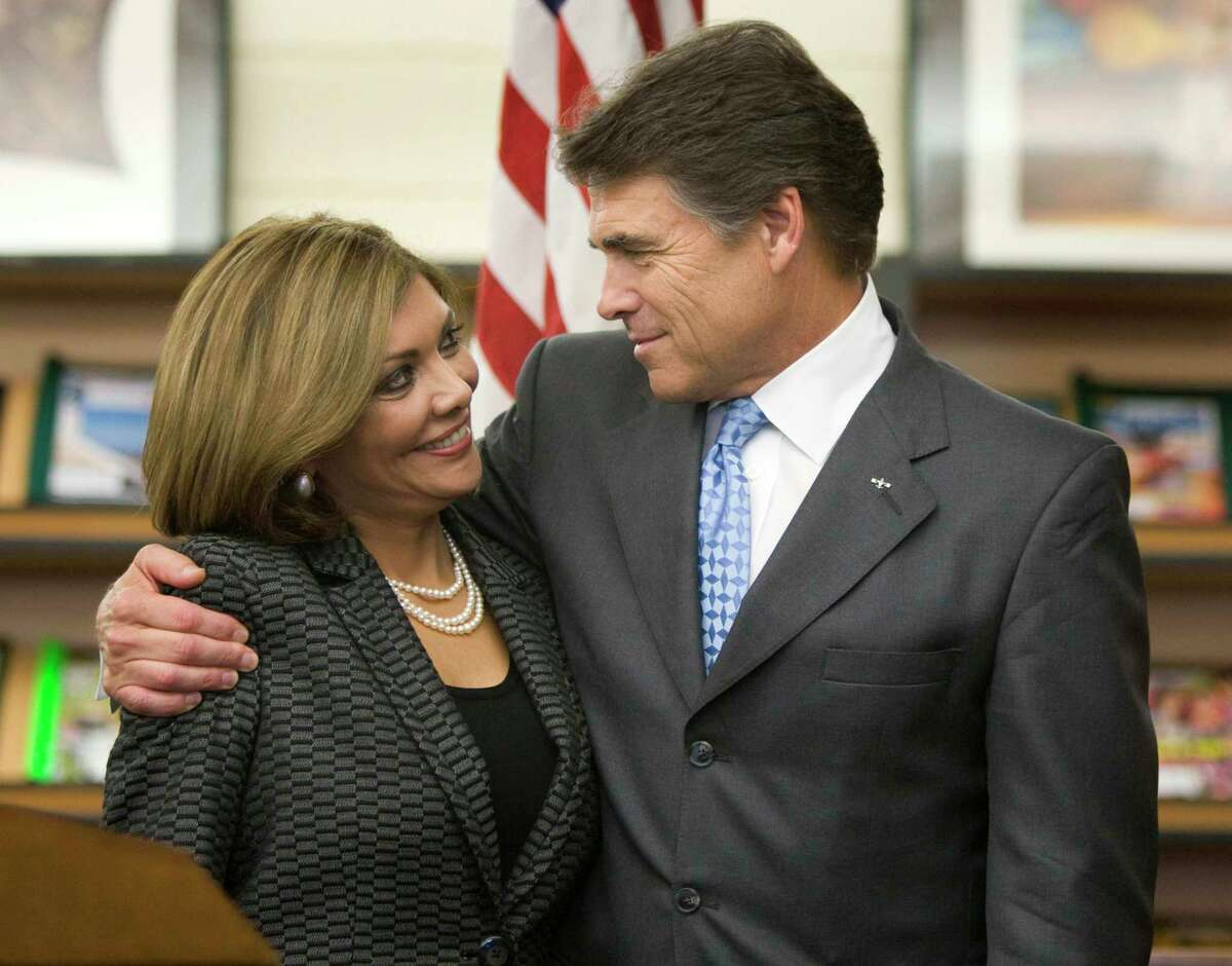 Judge Eva Guzman is embraced by then-Gov. Rick Perry in 2009 as he names her to the Texas Supreme Court. She was the first Hispanic woman to take a seat on bench.