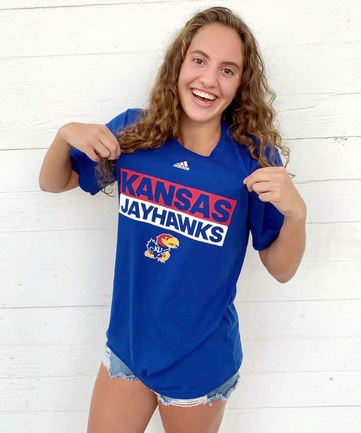 Eleni Kotzamanis, a senior at Alton High, has made a verbal commitment to swim at the University of Kansas next school year. Kotzamanis swims for the Flyers Aquatic Swim Team of St. Louis.