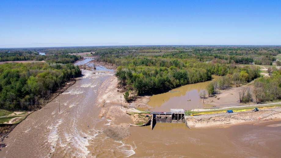 An aerial photo taken Thursday, May 21, 2020 shows the aftermath of record flooding following the breach of the Edenville Dam and failure of the Sanford Dam in Midland County. The Tittabwassee River reached a record 35.05 feet in Midland on Wednesday, May 20. (Adam Ferman/for the Daily News)
