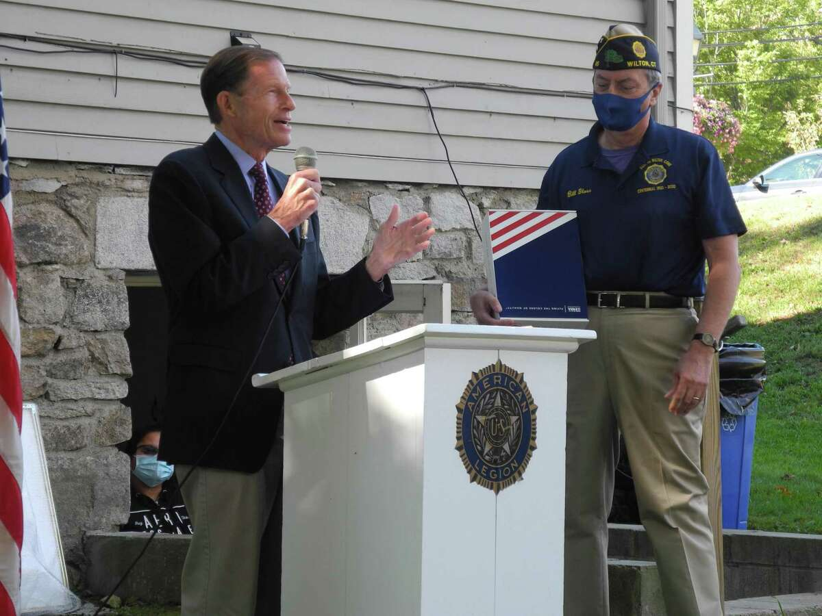 U.S. Senator Richard Blumenthal (D-Conn.) presents a flag that has flown over the Capitol in Washington, D.C. to Post 86 Commander Bill glass at the post's 100th anniversary celebration on Oct. 3, 2020.