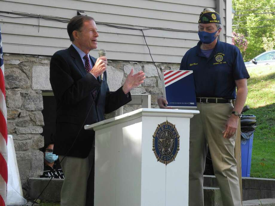 U.S. Senator Richard Blumenthal (D-Conn.) presents a flag that has flown over the Capitol in Washington, D.C. to Post 86 Commander Bill glass at the post's 100th anniversary celebration on Oct. 3, 2020. Photo: Jeannette Ross / Hearst Connecticut Media / Wilton Bulletin