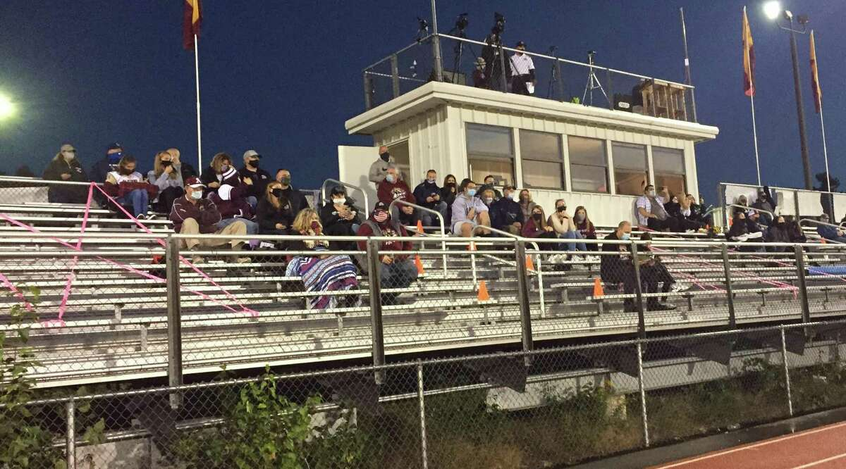 A limited number of fans were allowed for Alvirne football team's 2020 home opener due to COVID-19 restrictions in Hudson, N.H.