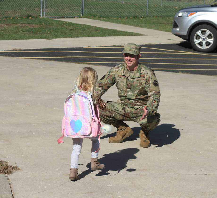 U.S. Air Force Senior Airman Matt Hansen picks up his daughter, Lennon, from preschool in Bear Lake on Tuesday. Hansen returned Friday after three months away for training, and is now making the most of his time with his family. Photo: Kyle Kotecki/News Advocate