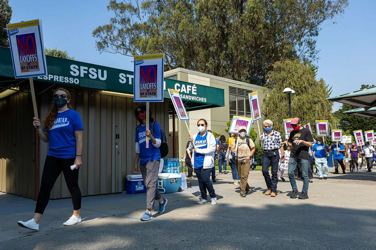 Demonstrators at San Francisco State University on Saturday protest staff layoffs, to take effect in November.
