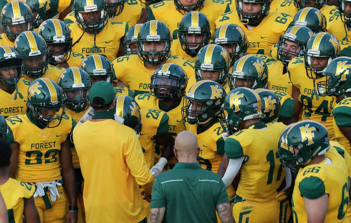 Klein Forest players gather before a non-district high school football game at Klein Memorial Stadium, Thursday, Oct. 1, 2020, in Spring.