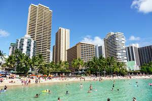 Hawaii, Hawaiian, Honolulu, Waikiki Beach, resort, Kuhio Beach State Park, Pacific Ocean, sunbathers, families, crowded, high rise buildings, hotel, condominium, Aston Waikiki Circle Hotel, Aston Waikiki Beach Tower, Pacific Beach Hotel,