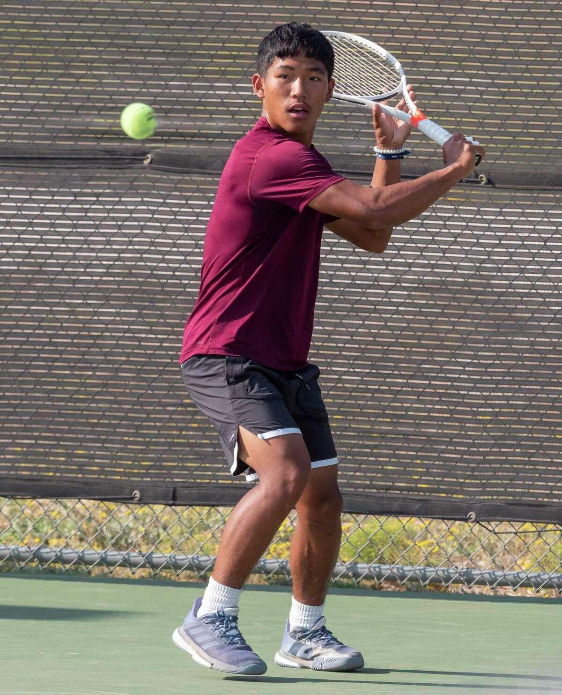 Lee High's Jehu Mang returns a shot 10/06/2020 at the Bush Tennis Center. Tim Fischer/Reporter-Telegram