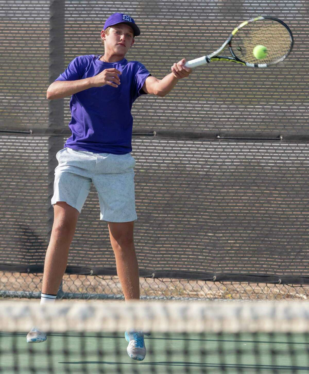 Midland High's Tyler Stewart returns a shot 10/06/2020 at the Bush Tennis Center. Tim Fischer/Reporter-Telegram