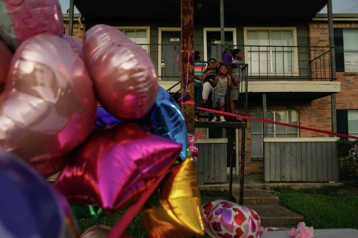 Maliyah Bass' neighbors looked onto the mourning friends and family at a vigil at the Sunset Crossing apartment complex in Alief on Saturday, August 29, 2020, where Maliyah was last seen.