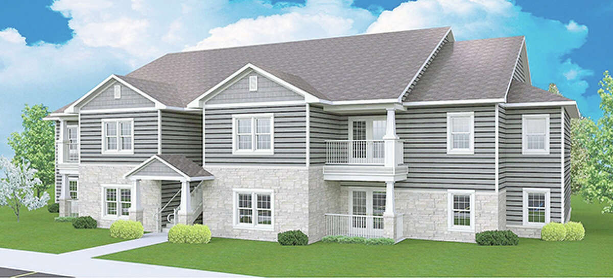 This is an architectural rendering of one of the planned two-story garden-style buildings that will be constructed at Diamond Apartments of Jerseyville, with four units on each level and a central breezeway providing access to the second story.