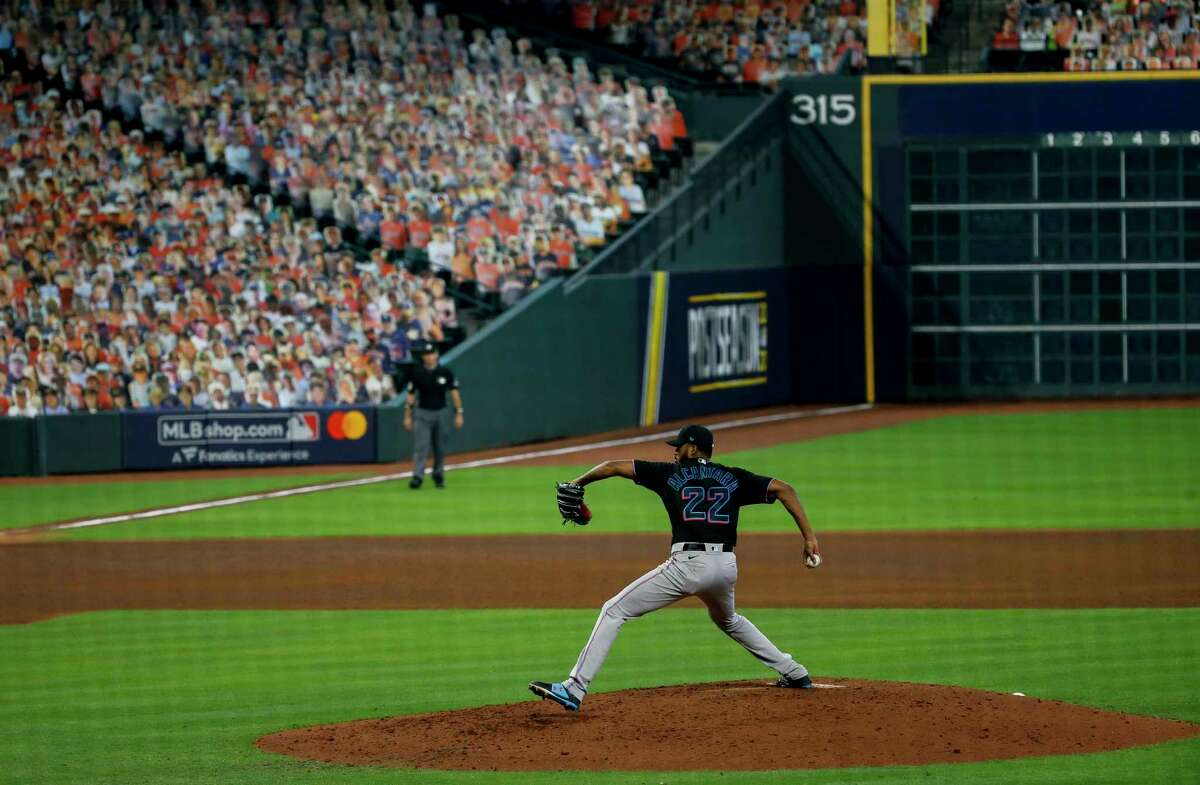 Miami Marlins starting pitcher Sandy Alcantara (22) throws against the Atlanta Braves during the fifth inning in Game 1 of the National League Division Series at Minute Maid Park on Tuesday, Oct. 6, 2020, in Houston.