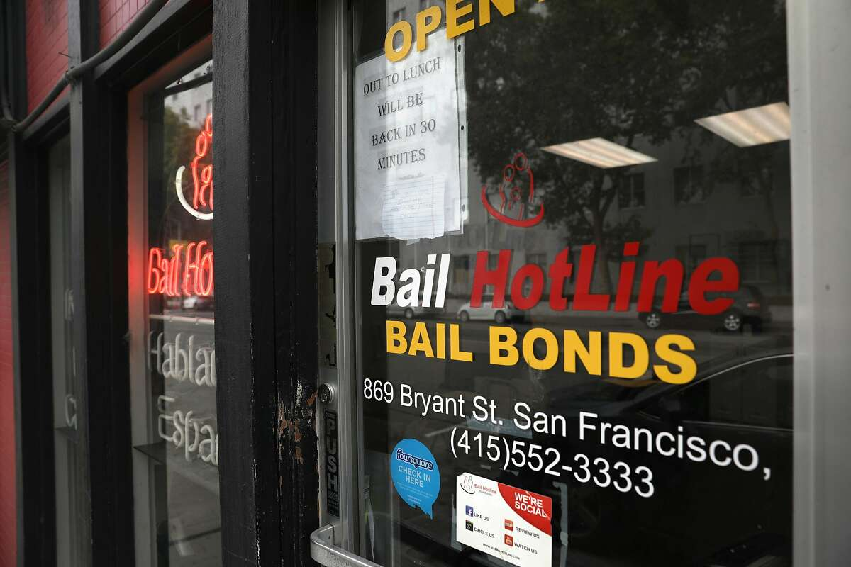 Bail bond offices across the street from the Hall of Justice in San Francisco. Defendants can't be locked up before trial simply because they can't afford to pay bail, the California Supreme Court has ruled.