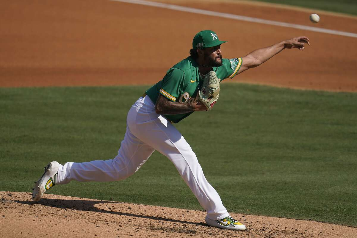Oakland Athletics pitcher Sean Manaea pitches against the Houston Astros during the fourth inning of Game 2 of a baseball American League Division Series in Los Angeles, Tuesday, Oct. 6, 2020. (AP Photo/Marcio Jose Sanchez)