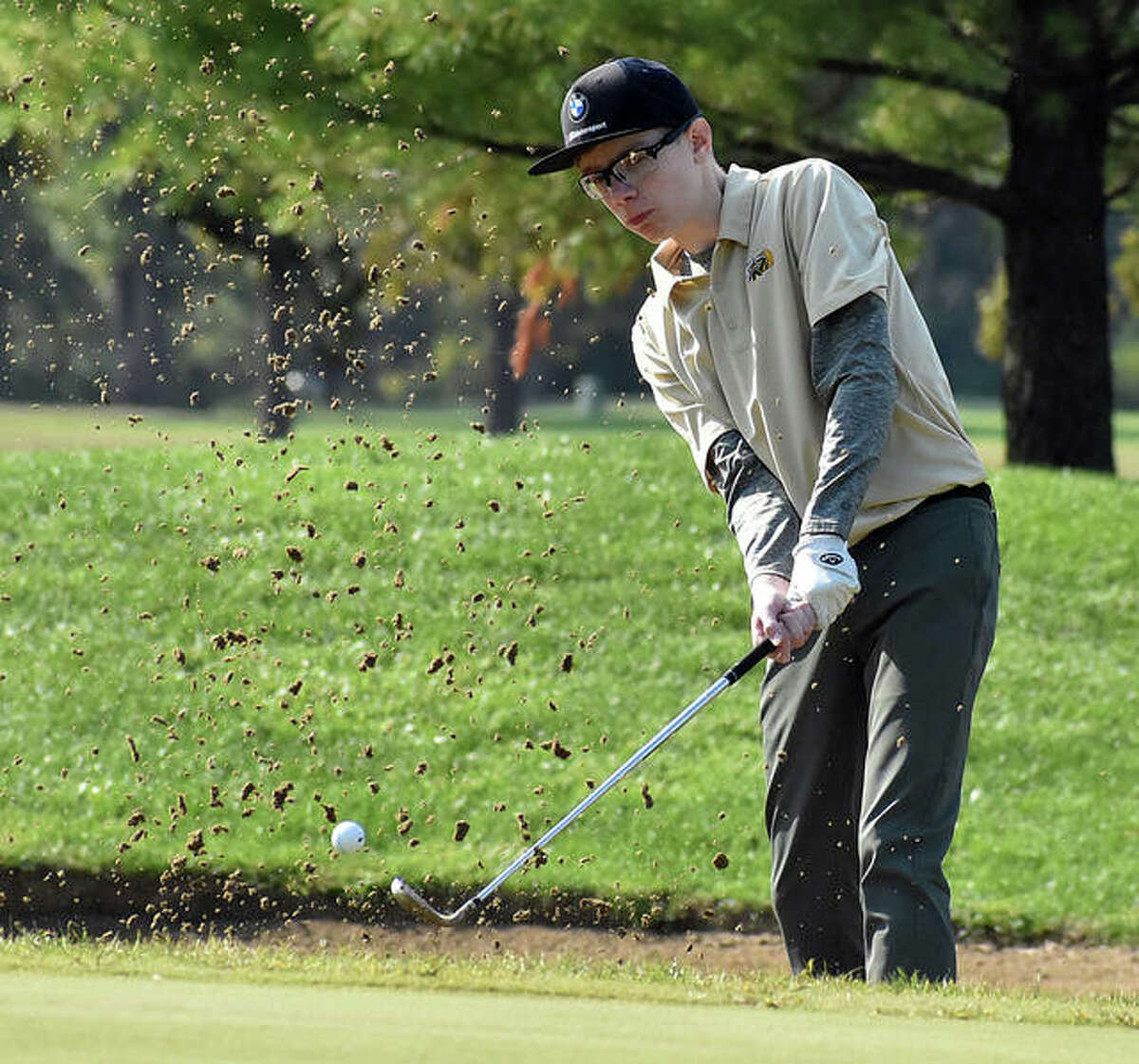Metro-East Lutheran's Charlie Fedder hits his shot out of the bunker and onto the green on No. 13 at Timber Lakes Golf Course in Staunton on Tuesday during the Class 1A Mount Olive Regional.
