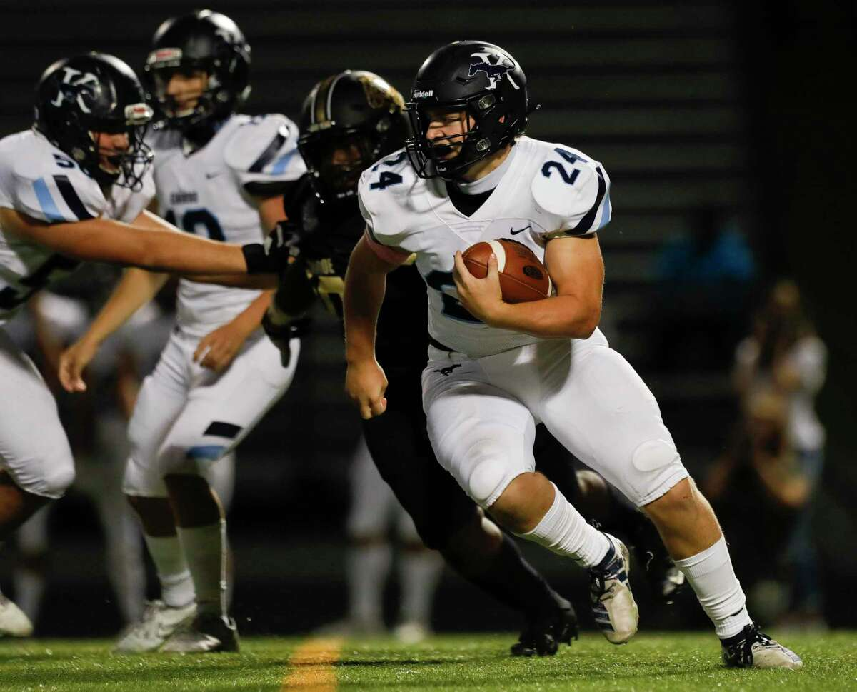 Kingwood running back Nick Bernell (24) runs the ball during the second quarter of a non-district high school football game at Buddy Moorhead Stadium, Friday, Oct. 2, 2020, in Conroe.
