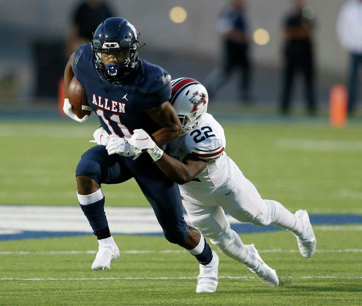 Allen's Jordan Johnson (11) is brought down by Humble Atascocita's Davon Bacon (22) during a run play in the first quarter of play at Eagle Stadium in Allen, Texas on Friday, October 2, 2020. (Vernon Bryant/The Dallas Morning News)