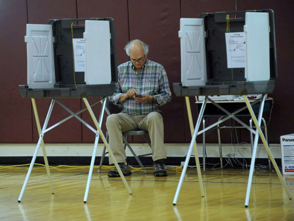 Tim Beeble, Republican registrar of voters in Bethel, is part of a team setting up the Berry Elementary School polling place Monday, August 8, 2016, for Tuesday's Republican primary in the probate judge race.