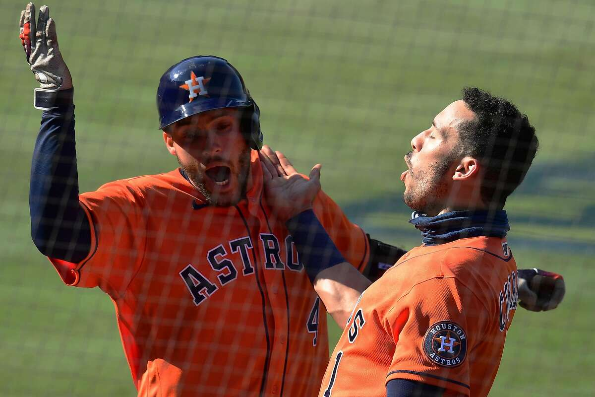 George Springer #4 of the Houston Astros celebrates a home run against the Oakland Athletics with Carlos Correa #1 during the fifth inning in Game Two of the American League Division Series at Dodger Stadium on October 06, 2020 in Los Angeles, California.
