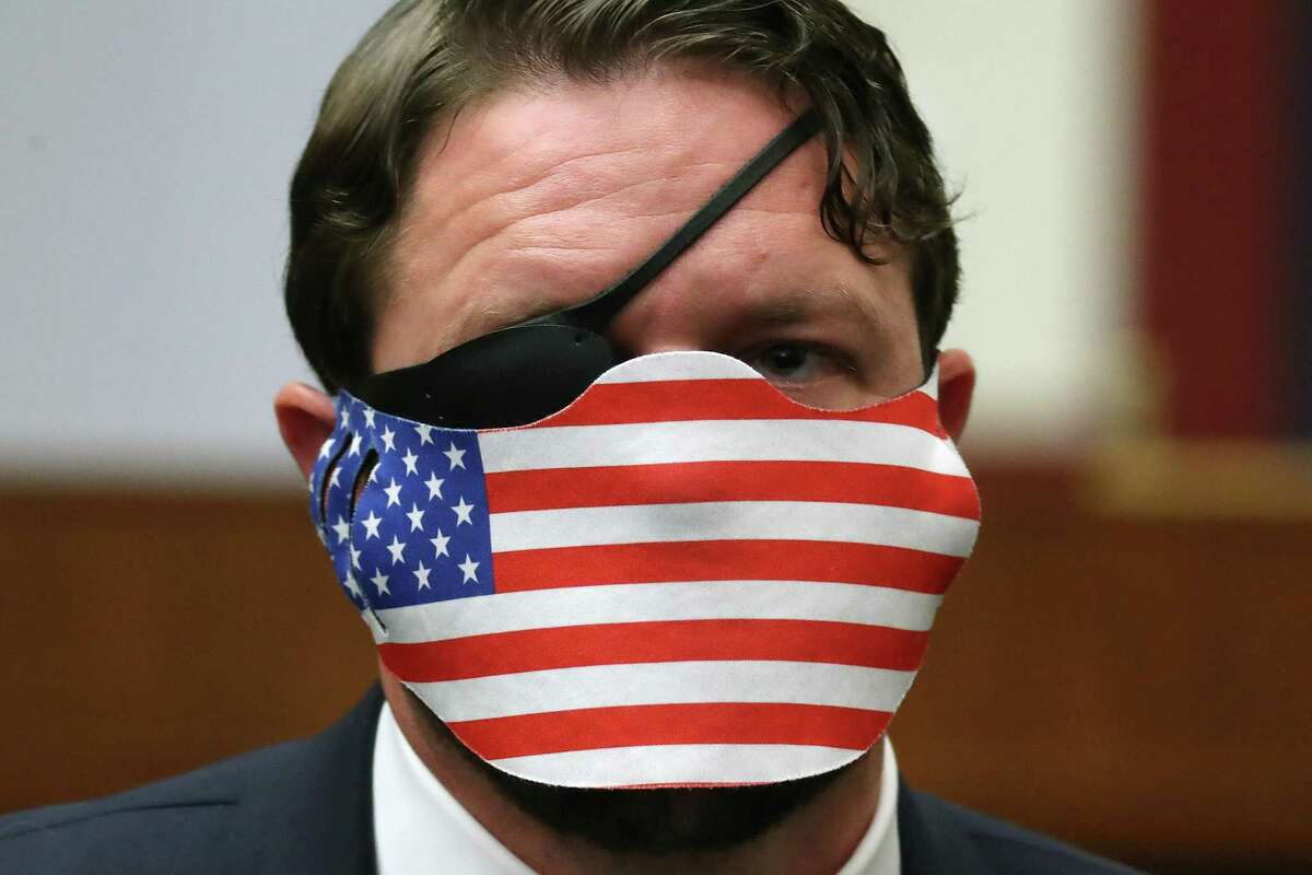 Representative Dan Crenshaw, a Republican from Texas, wears a protective mask during a House Homeland Security Committee security hearing in Washington, D.C., U.S., on Thursday, Sept. 17, 2020. The hearing focused on international terrorism threats, the rise in domestic terrorism incidents and recent shootings as well as election security and cyber threats. Photographer: Chip Somodevilla/Getty Images/Bloomberg