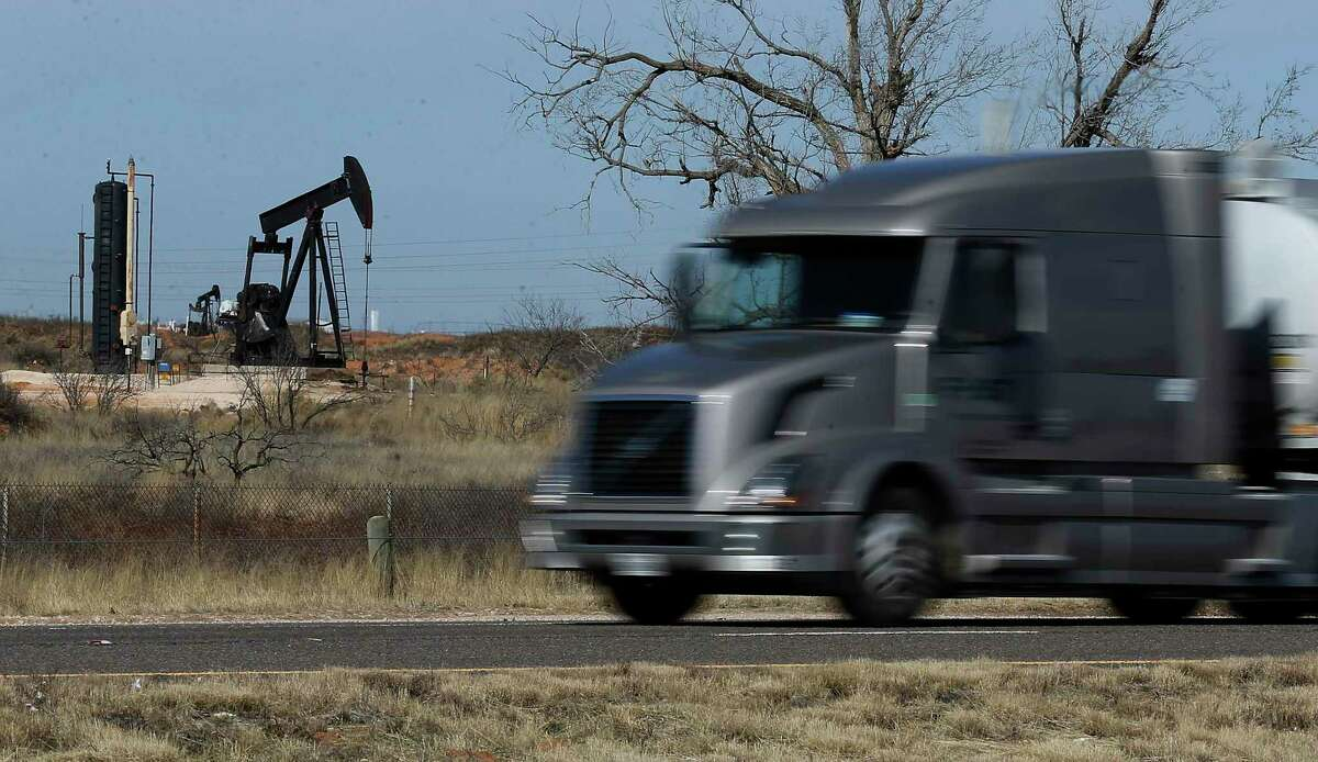 A commercial truck zooms past a pump jack near Andrews, Texas. According to the town's business leadership, Andrews' main revenue generator is oil and oil field services. Waste Control Specialists (WCS) near Andrews, Texas provides services to store low-level nuclear waste and is in the process of applying for a license to be an interim storage facility for high-level radioactive waste. Gov. Greg Abbott last week publicly asked the U.S. Nuclear Regulatory Commission to deny an application for a high-level nuclear waste storage site in Andrews County.