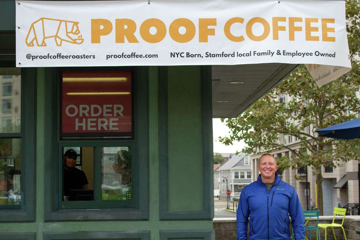 Proof Coffee Roasters CEO Jeff Sale stands outside his new establishment in Harbor Point's Commons Park.
