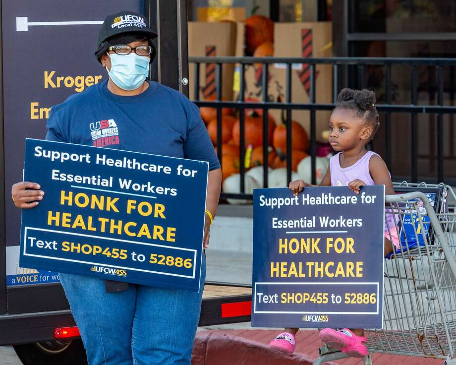 Kroger employees picketed outside the Dowlen Road store on Tuesday afternoon as the company is shrinking their hazard pay and medical benefits during the pandemic. Photo made on October 06, 2020. Fran Ruchalski/The Enterprise Photo: Fran Ruchalski/The Enterprise / © 2020 The Beaumont Enterprise