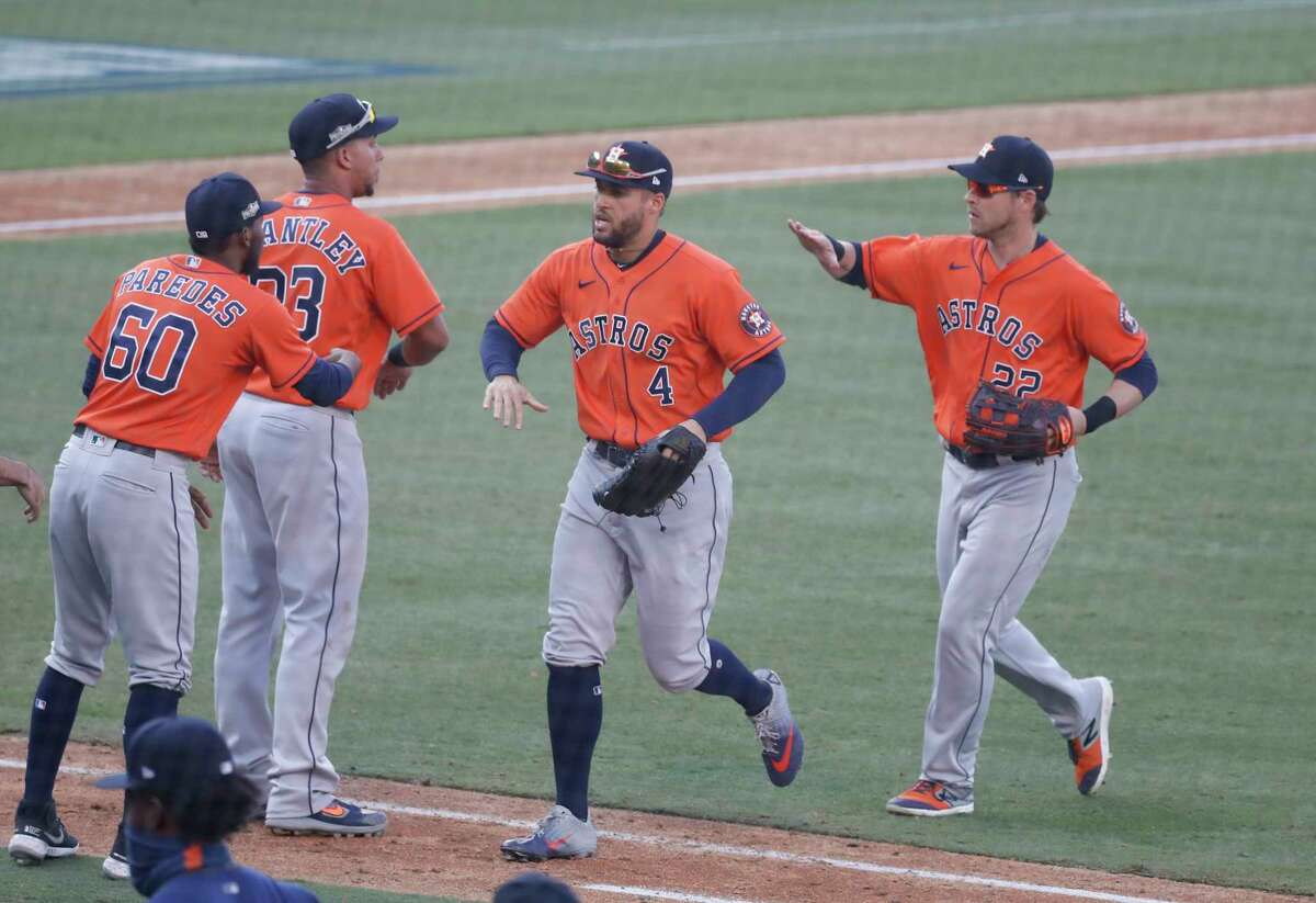 Houston Astros George Springer (4) and Josh Reddick (22) celebrated with pitcher Enoli Paredes (60) and Michael Brantley (23) after the Astros 5-2 beat the Oakland Athletics after Game 2 of the American League Division Series, at Dodger Stadium, Tuesday, October 6, 2020, in Los Angeles.