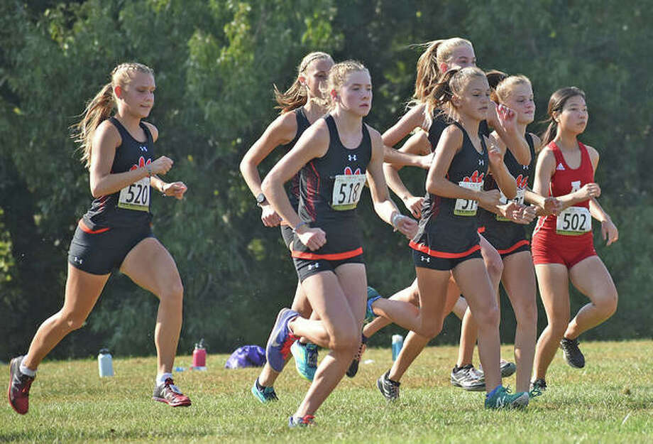 The Edwardsville girls cross country team gets off to a fast start at the Madison County Meet on Tuesday in Alton. Photo: Matt Kamp|The Intelligencer